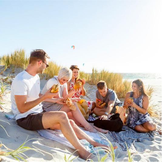 Group enjoying Flipside Burgers at the beach